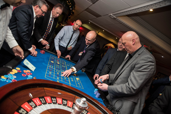 Guests enjoying the after-dinner charity casino